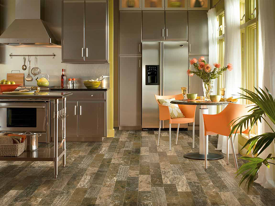 Eclectic styled kitchen that has porcelain tile wood-look flooring in varying colours